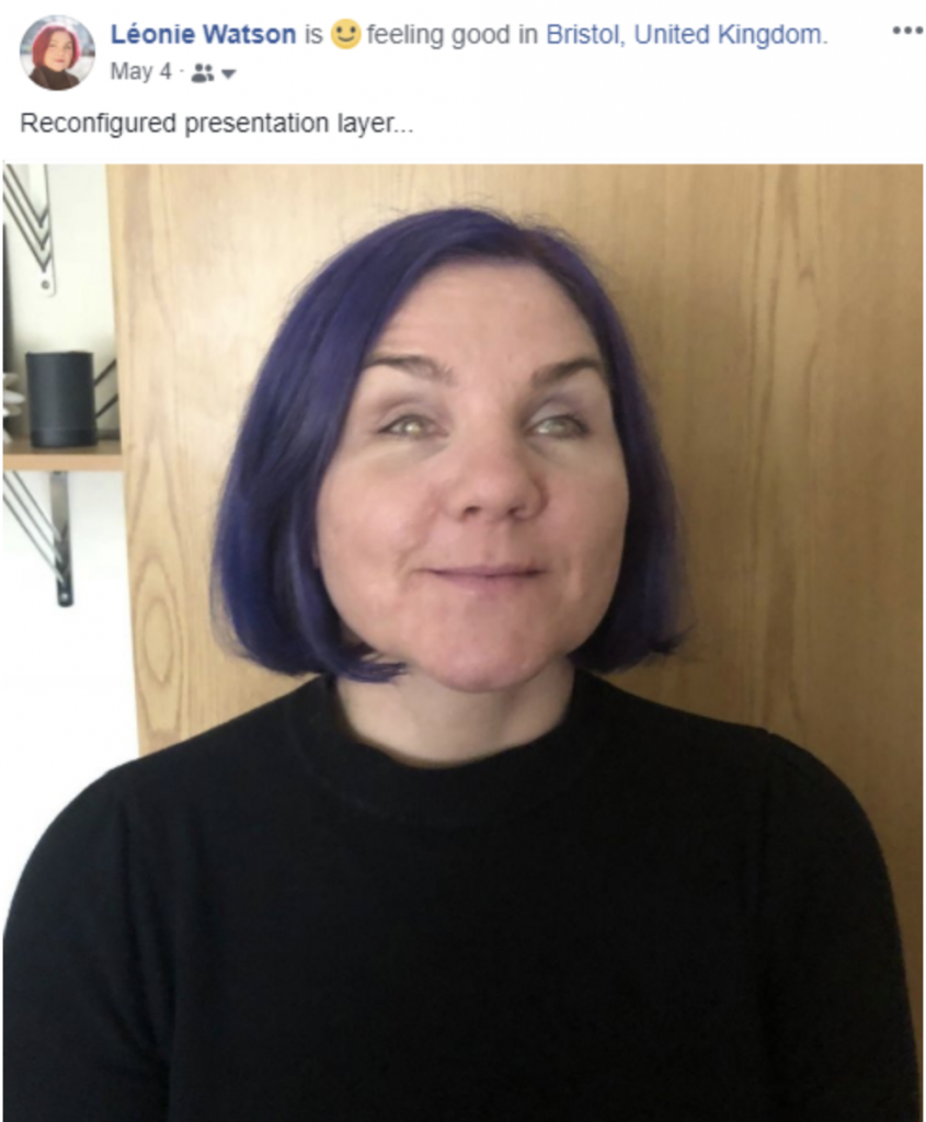 """Screenshot of Facebook status update. A photo of Léonie with her new purple hair is followed with status text stating """"reconfigured presentation layer"""""""